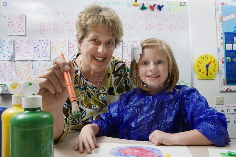 Teacher And Student Painting stock photo