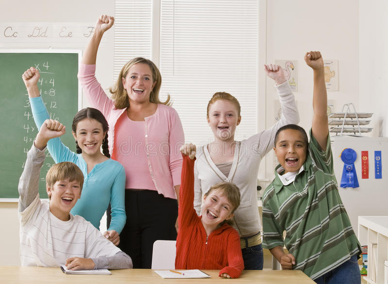 Teacher and students cheering royalty free stock image