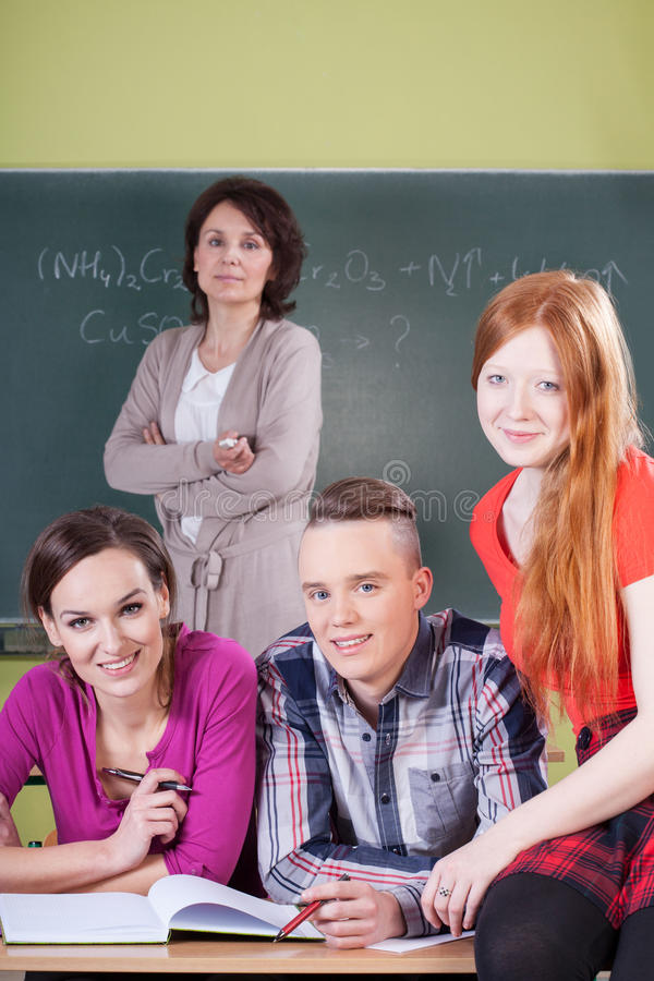 Teacher And Students During Chemistry Lesson Stock Photo