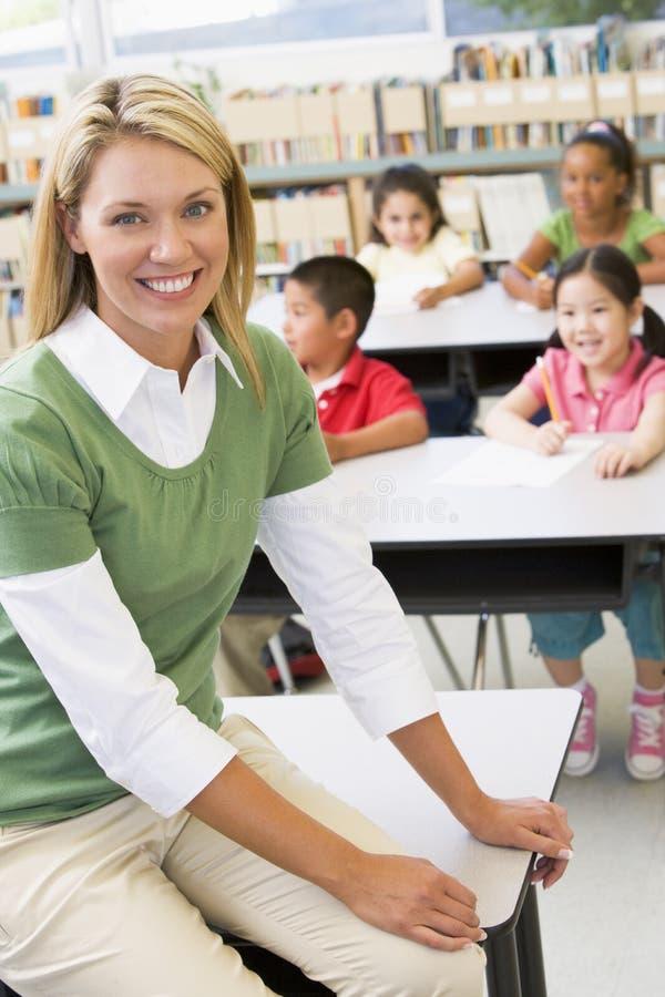 Teacher and students in kindergarten class stock photography