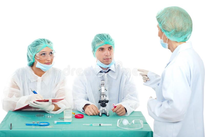 Teacher with students in laboratory stock images