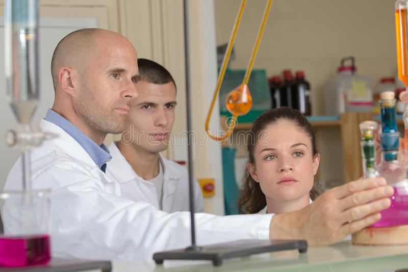 Teacher with students in laboratory royalty free stock photography