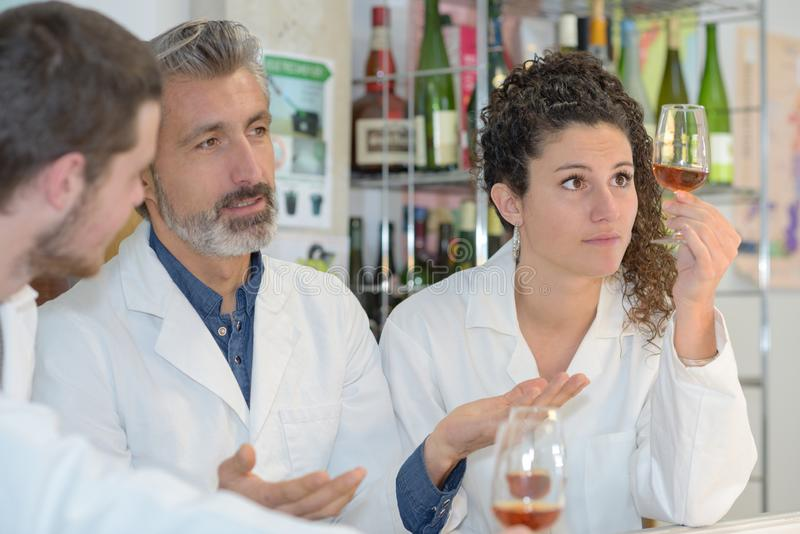 Teacher and students making experienced on wine stock image