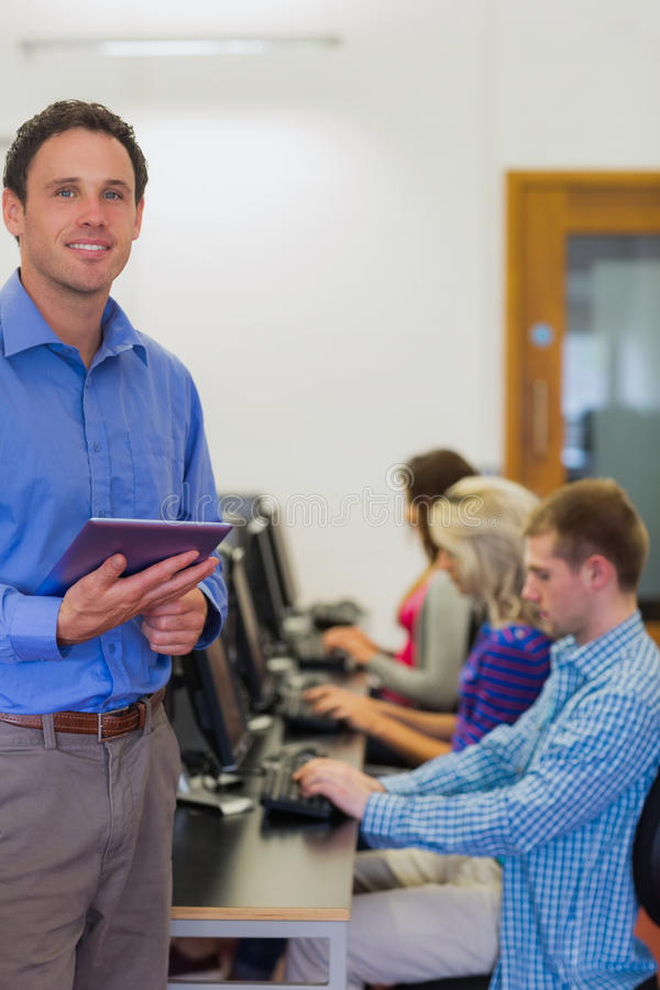 Download Teacher With Students Using Computers In Computer Room Stock Image - Image: 35788861