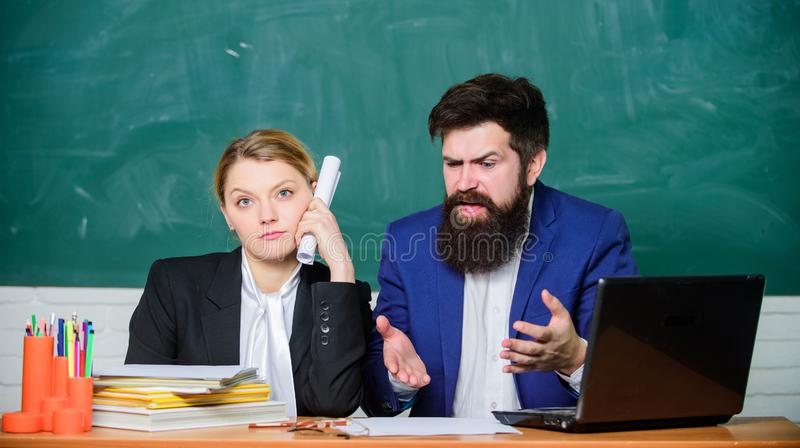 Teacher and supervisor working in school classroom. School educator and schoolmaster different opinion. School staff. School collective and relations between royalty free stock photography