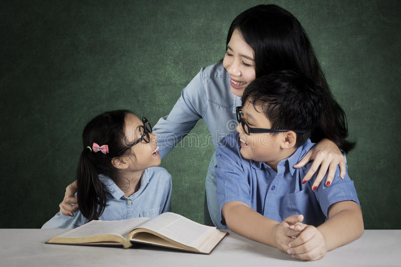 Teacher talking with students in the class royalty free stock photo