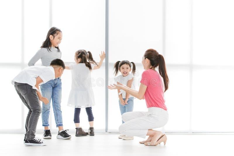 Teacher teaching kids in acting class. stock image