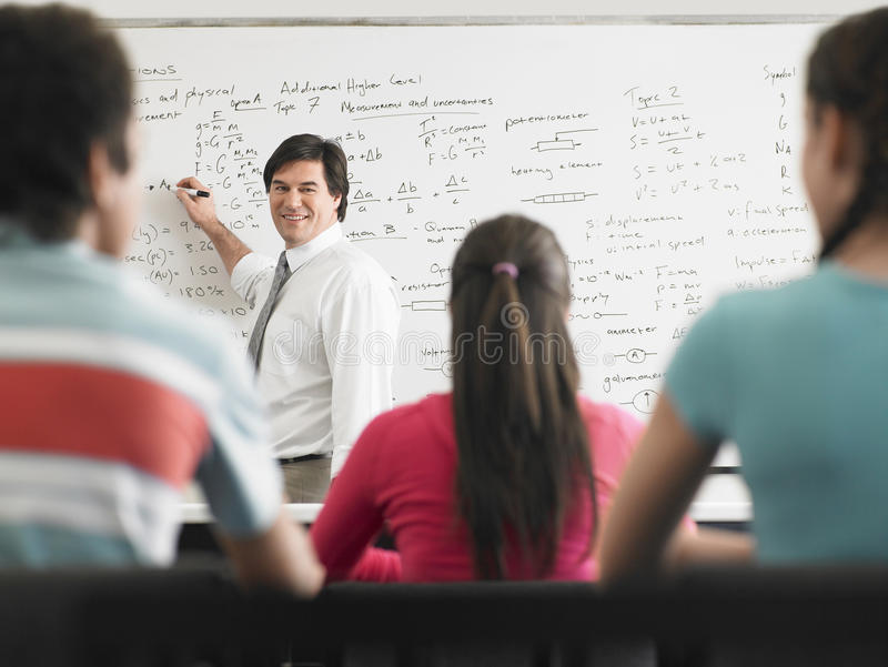 Teacher Teaching To Students In Class stock images