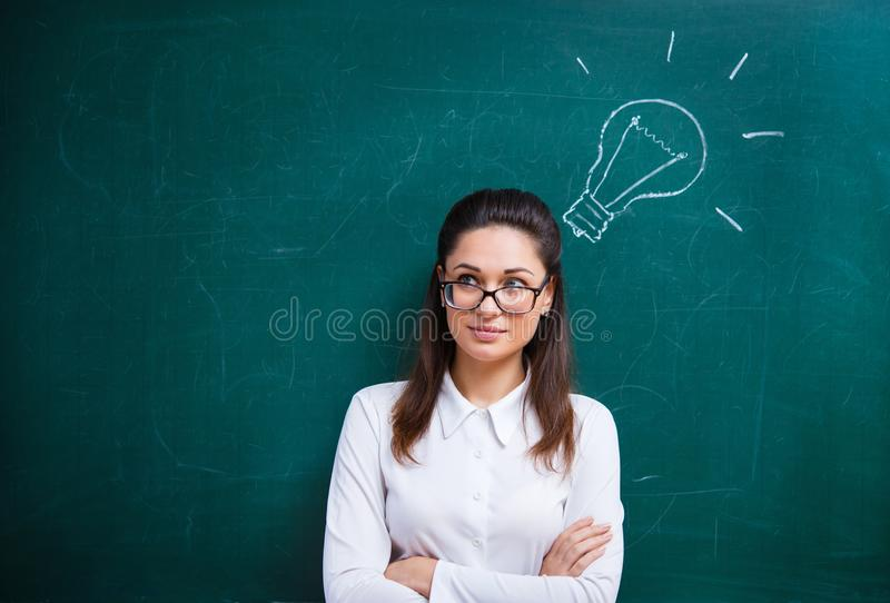 The teacher thinks near the board stock photo