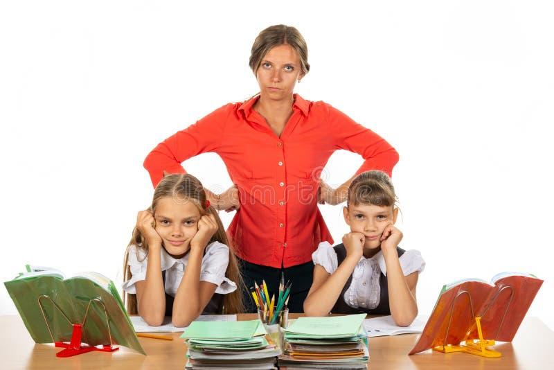 Teacher tired of stupid children stock image
