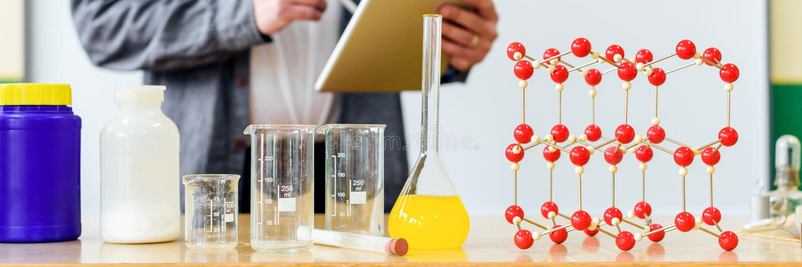Teacher using digital tablet to teach students in chemistry class. Education, VR, Tutoring, New Technologies and Teaching Methods. stock photo