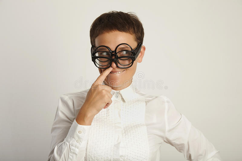 Teacher in white blouse with 3 pairs of glasses stock images