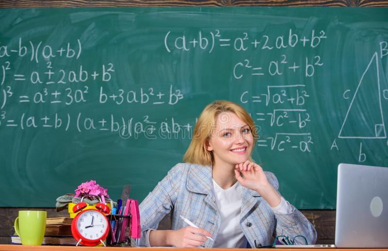 Teacher woman sit table chalkboard background. Organize class and make learning easy and meaningful process. Well. Organized and committed teacher. Excellent stock photo