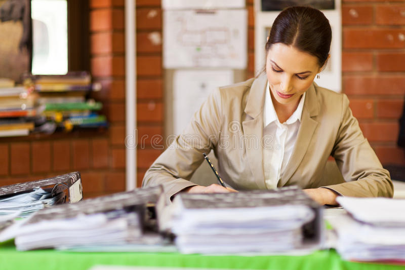 Teacher working in office royalty free stock photo