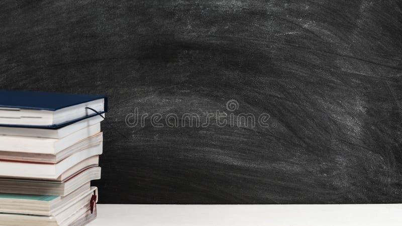 Teacher workplace books desk empty chalkboard stock photography