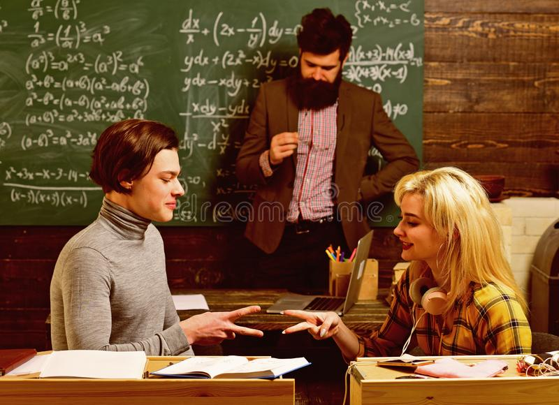 Teachers know about things that make students curious. Final exam test in university students study for examination in stock photography