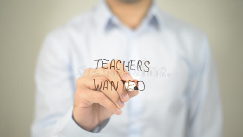 Teachers Wanted , man writing on transparent screen stock image