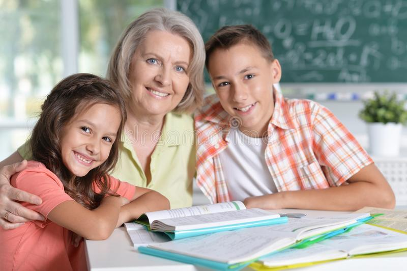 Teachers working with pupils. In computer class royalty free stock photography