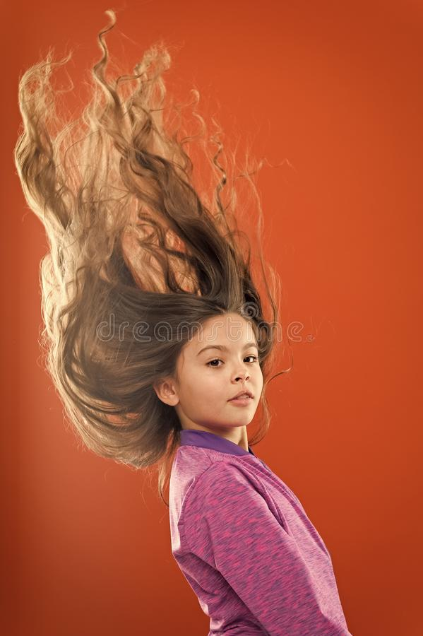 Teaching child healthy hair care habits. Kid girl long healthy shiny hair. Main thing is keeping it clean. Use gentle royalty free stock image