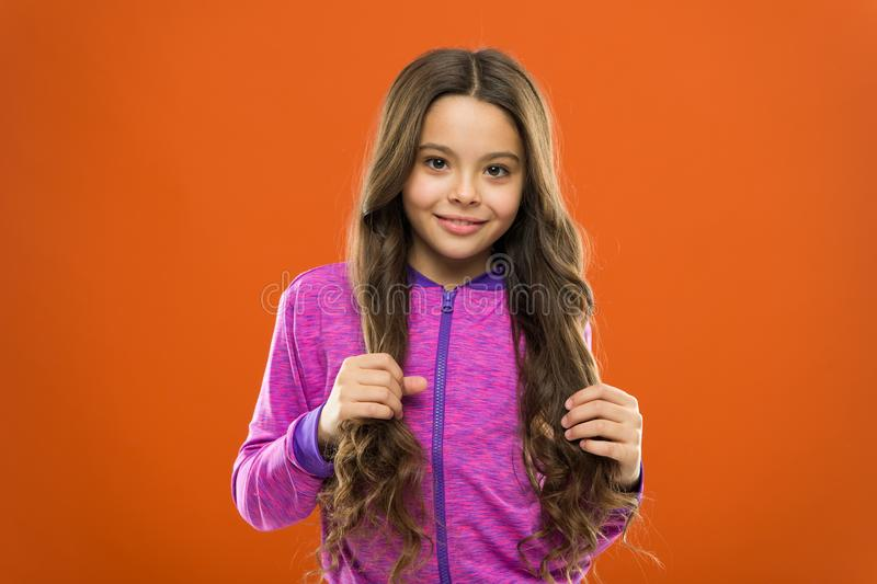 Teaching child healthy hair care habits. Strong hair concept. Kid girl long healthy shiny hair. Main thing is keeping it stock photo