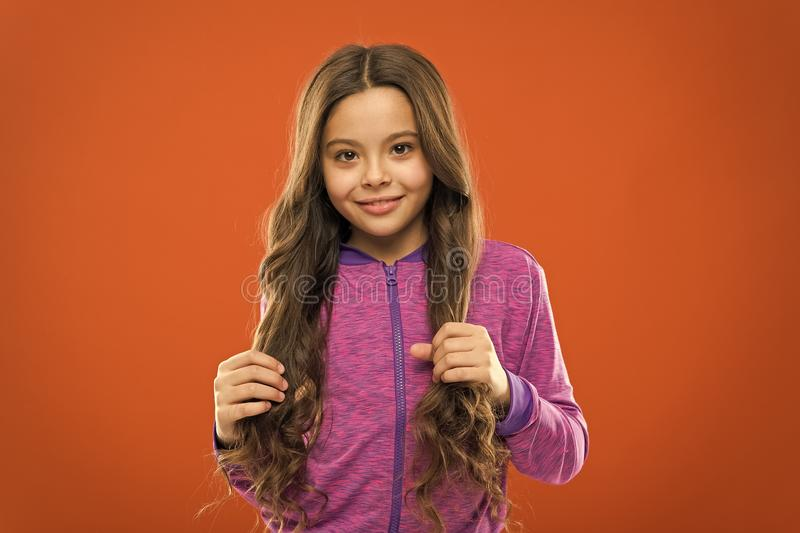 Teaching child healthy hair care habits. Strong hair concept. Kid girl long healthy shiny hair. Main thing is keeping it stock photography