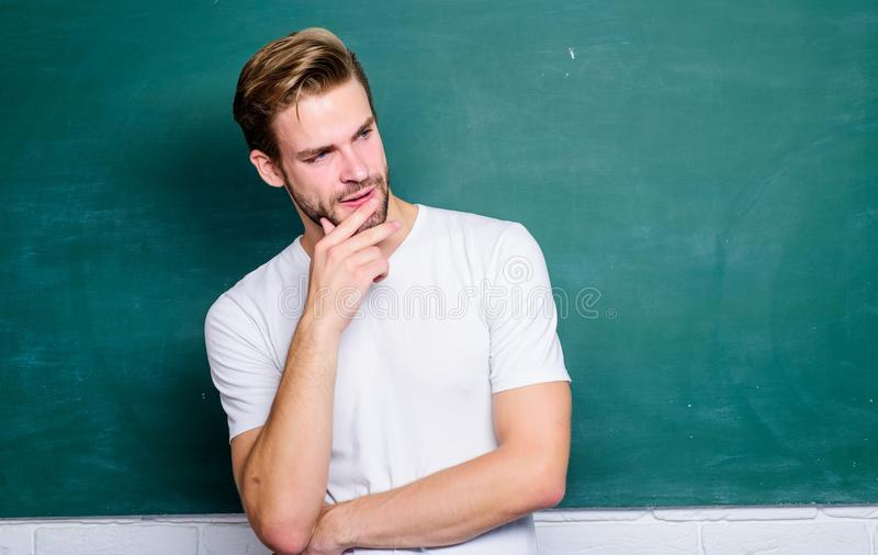 Teaching could be more fun. Source of energy and inspiration. Lets begin lesson. Man teacher in front of chalkboard. Advantages for male elementary teacher are stock image