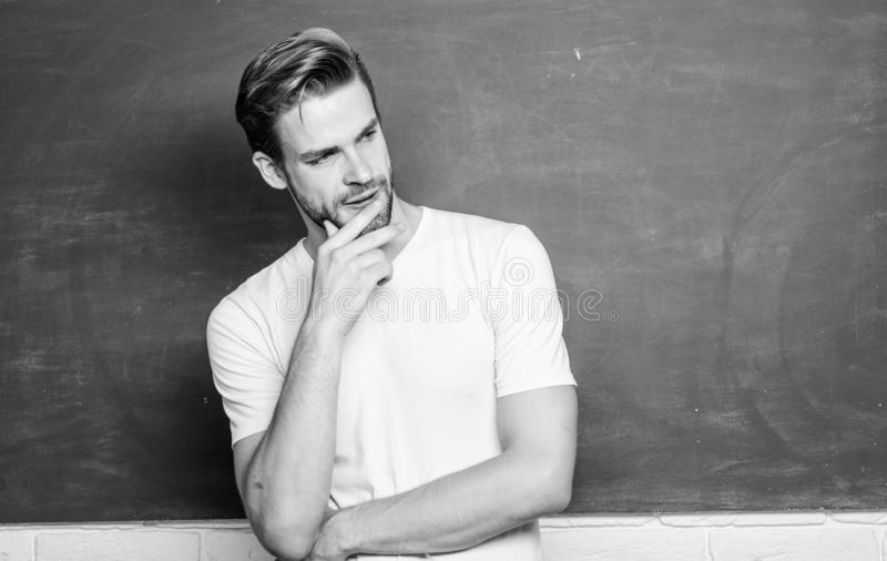 Teaching could be more fun. Source of energy and inspiration. Lets begin lesson. Man teacher in front of chalkboard. Advantages for male elementary teacher are royalty free stock photos