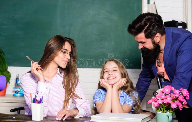 Teaching daughter. Favorable conditions for learning. Good learning environment. Learners must feel supported welcomed. And respected. Mom and dad teachers stock photography