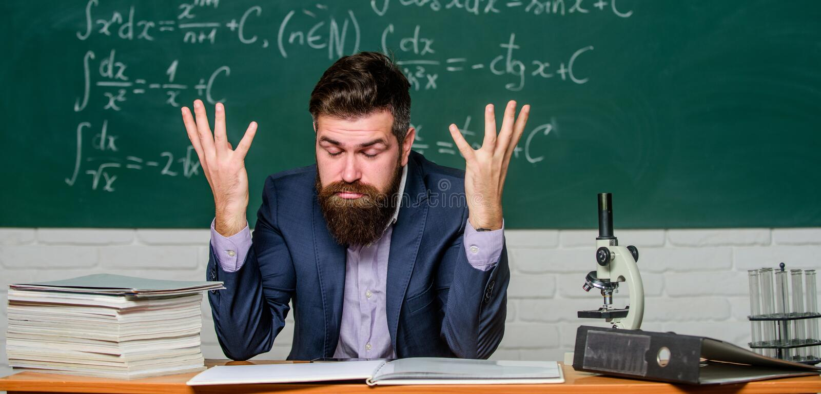 Teaching dumb students. Teacher mature man. Fed up. Difficult work. Emotional burnout. Teacher give up. Hate his job royalty free stock photos