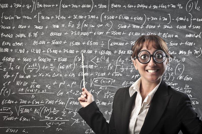 Teaching Maths. A strange teacher is explaining maths stock photo