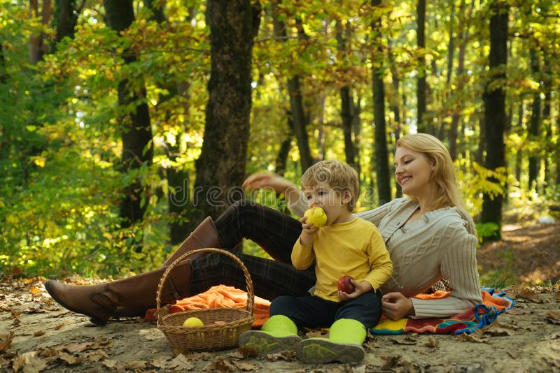 Teaching son healthy nutrition. Having snack picnic hike. Happy childhood. Mother pretty woman and little son relaxing royalty free stock photo