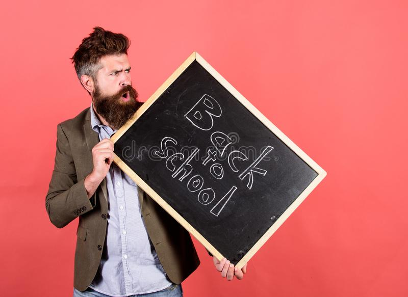 Teaching stressful occupation. Take it easy. Teacher with tousled hair stressful about school year beginning. Teacher. Bearded man holds blackboard with royalty free stock photography