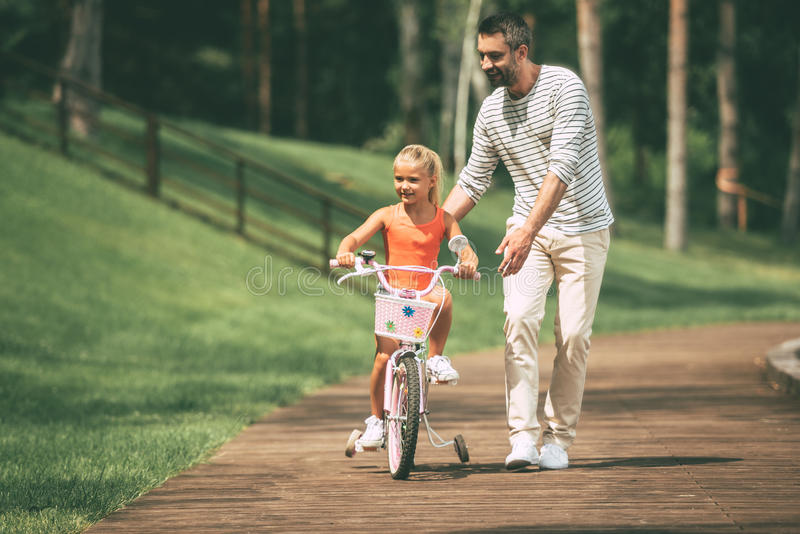 Teaching to ride bicycle. royalty free stock photography