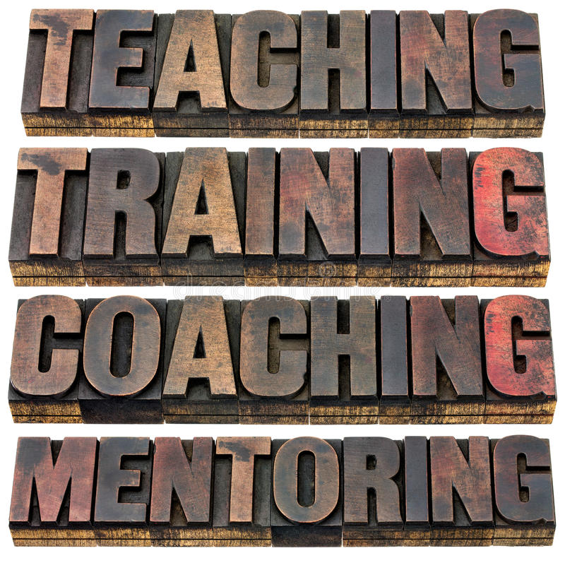 Teaching, training, coaching and mentoring stock photo