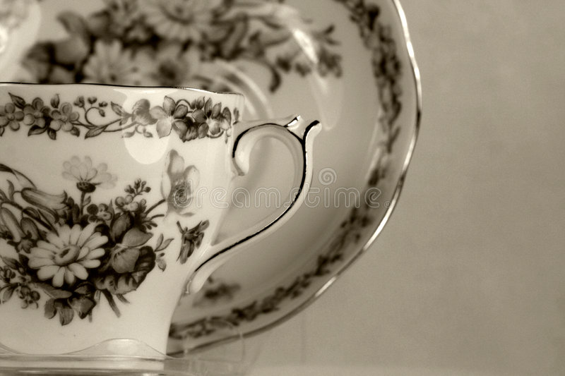 Teacup antigo no branco fotografia de stock royalty free