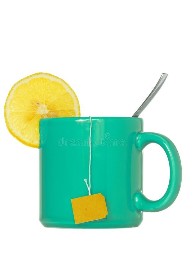 Teacup med en citronskiva arkivbild