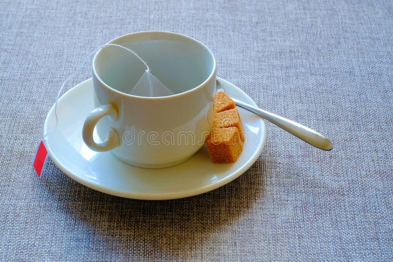 teacup Rottingsocker, fruktte i en påse fotografering för bildbyråer