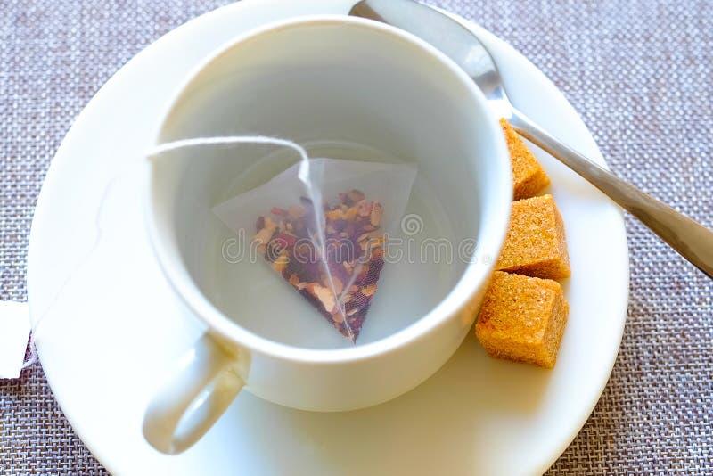 teacup Rottingsocker, fruktte i en påse arkivfoto