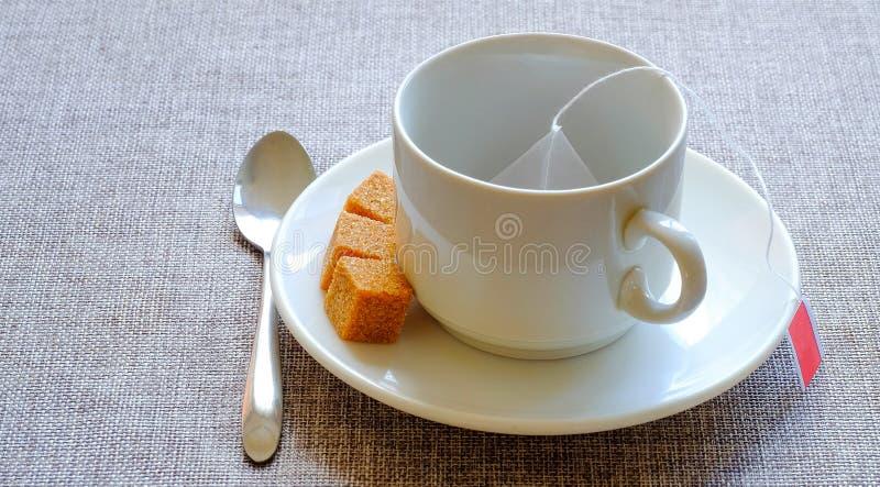 teacup Rottingsocker, fruktte i en påse arkivfoton