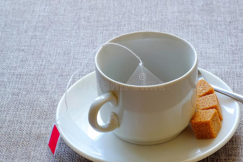 teacup Rottingsocker, fruktte i en påse royaltyfria foton