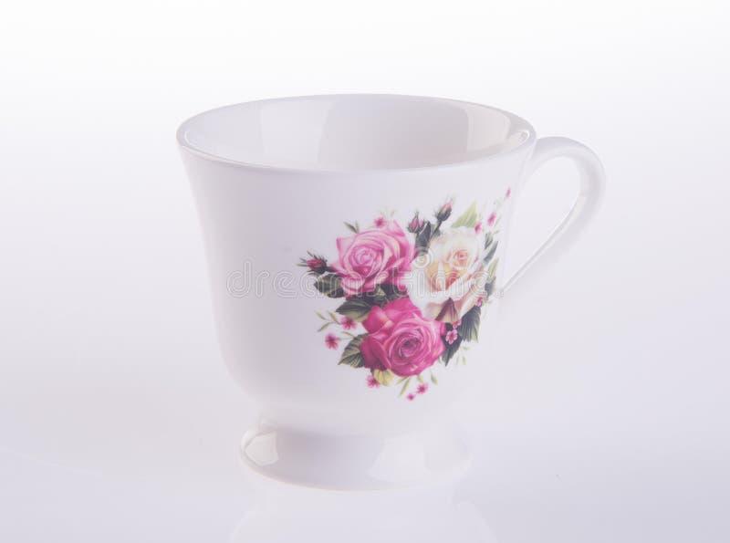 teacup tekopp på en bakgrund arkivbild