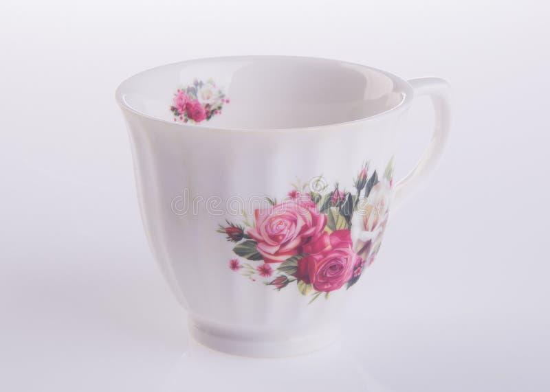 teacup tekopp på en bakgrund royaltyfria bilder