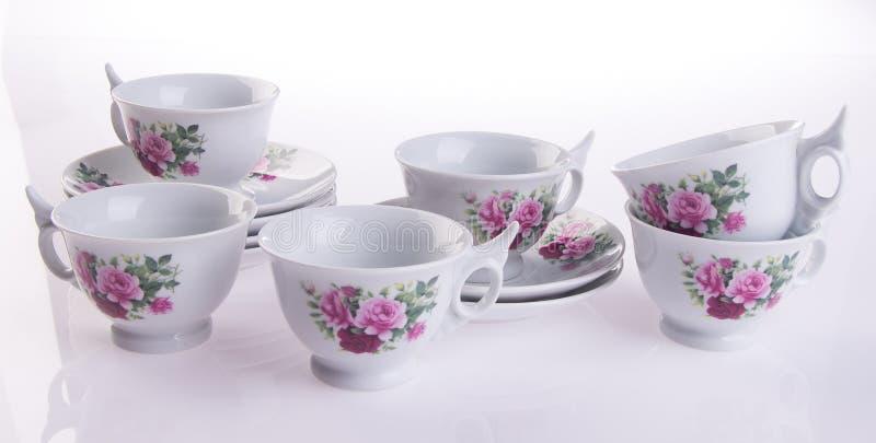 teacup tekopp på en bakgrund royaltyfri bild