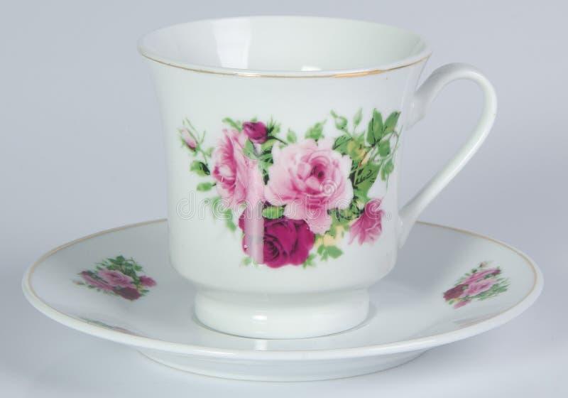 teacup tekopp på en bakgrund royaltyfria foton