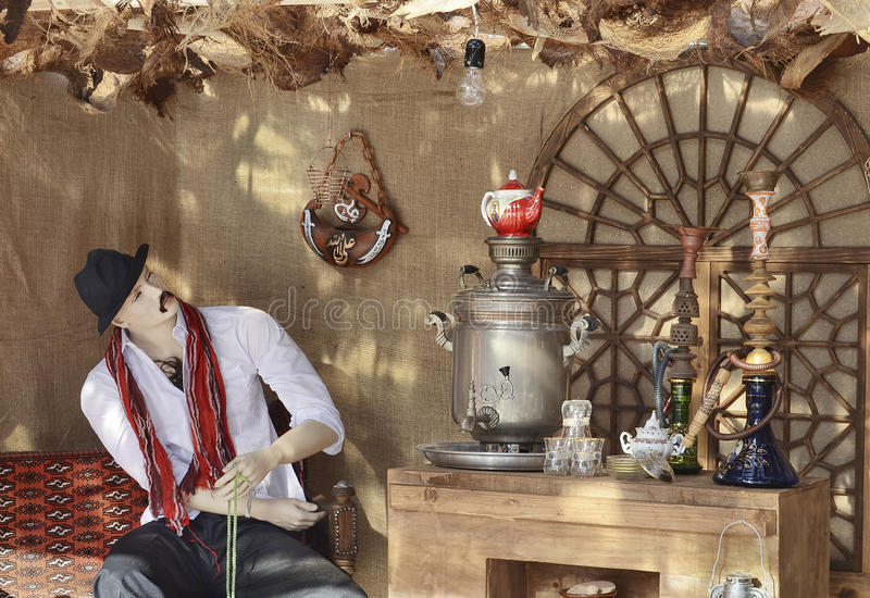 Teahouse. A figure in a traditional persian teahouse decor stock photo
