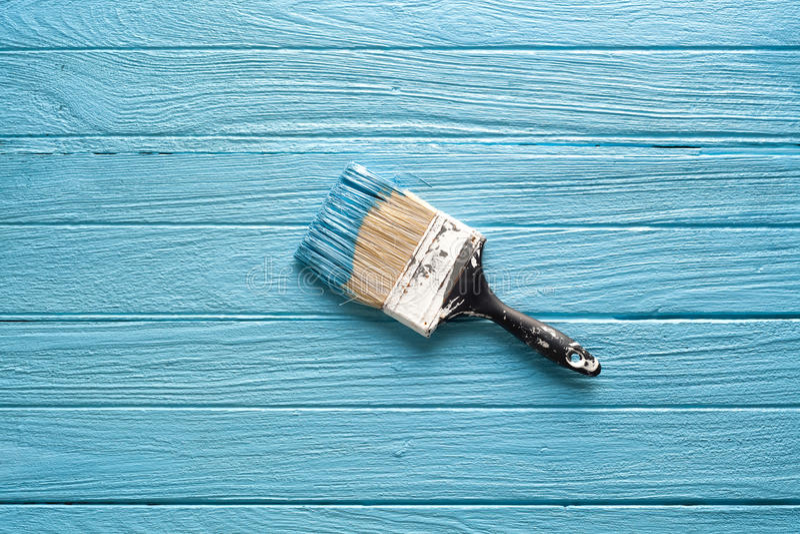 Teak εργαλείων επιστρώματος πινέλων μπλε ξύλινο ξύλινο ακόμα υπόβαθρο ζωής στοκ φωτογραφίες