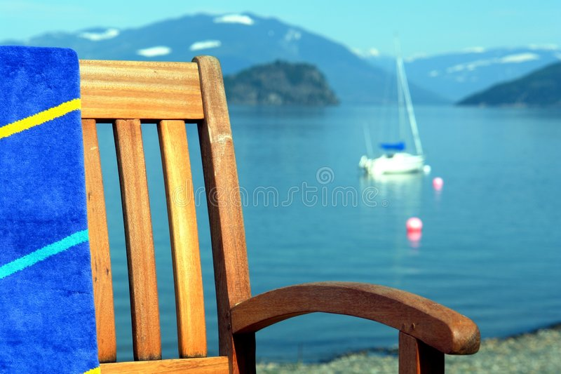 Teak Patio Chair. On the beach at the Shuswap lake in British Columbia stock photography