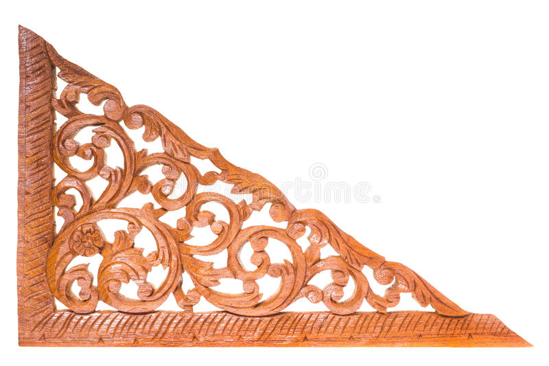 Teak wood carving. Traditional teak wood carving for decoration isolated on white background royalty free stock photography