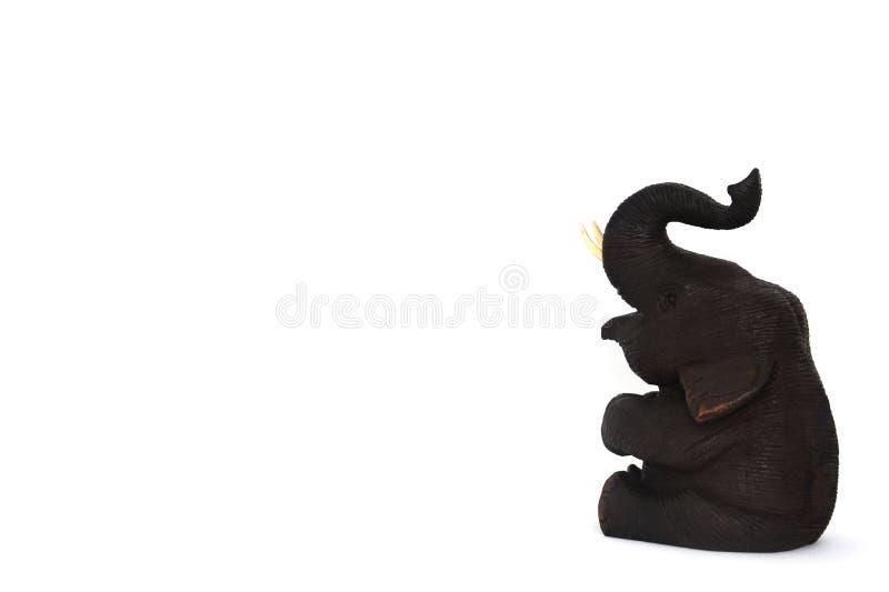 Teak wood elephant isolated on white background, copy space. Brown color teak wood elephant isolated on white background, copy space royalty free stock photo