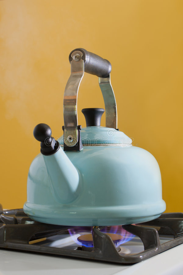 Teakettle. A kettle full of water boiling on a stove top stock photos